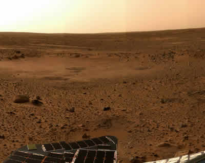 This picture shows a close up of the surface of Mars - dusty soil and rocks.